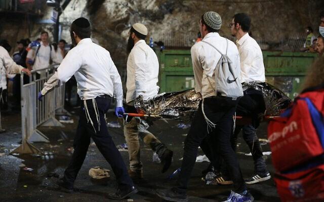 Izraelskie siły ratownicze i policja na miejscu katastrofy
